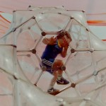 child climbing in a bubble